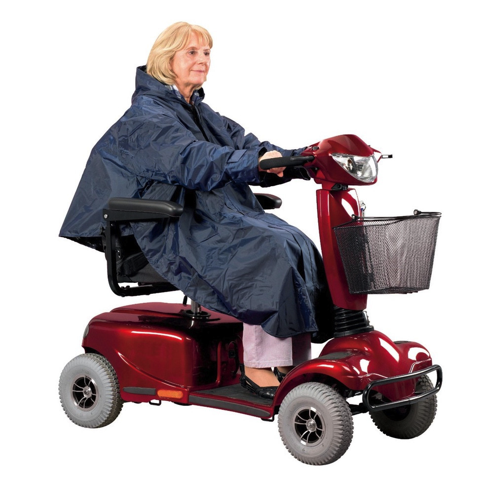 Lady-sat-on-a-mobility-scooter-wearing-a-poncho