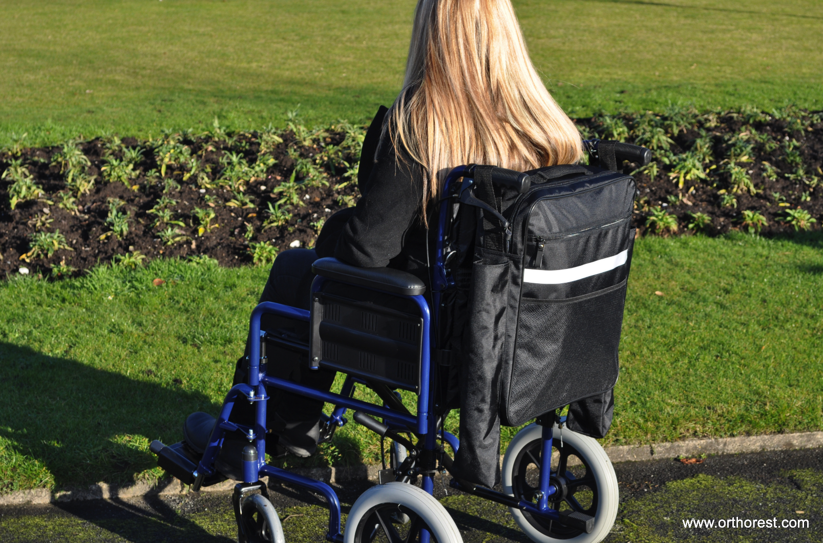 lady-sat-in-a-wheelchair-with-a-bag-on-the-back